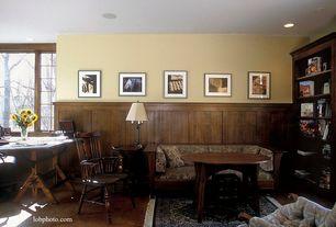 Craftsman Home Office with sandstone floors, Chair rail, Standard height, can lights, Casement, Built-in bookshelf