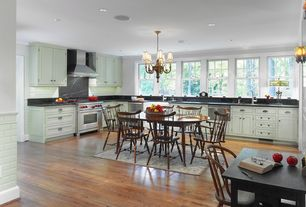 Traditional Kitchen with Pendant light, Soapstone counters, Flat panel cabinets, single dishwasher, Standard height, Casement