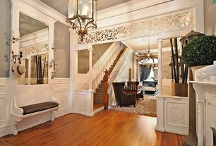 Traditional Staircase with Chandelier, Columns, Crown molding, Wainscotting, Chair rail, Hardwood floors