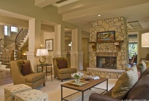 Traditional Living Room with Columns, Hardwood floors, stone fireplace, Exposed beam, Crate & Barrel Tess Chair, High ceiling