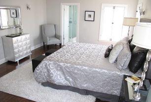Art Deco Master Bedroom with flat door, Standard height, Casement, Hardwood floors, Wall sconce