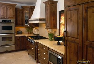 Traditional Kitchen with Standard height, Gas rangetop, double wall oven, full backsplash, Raised panel, Marble countertop