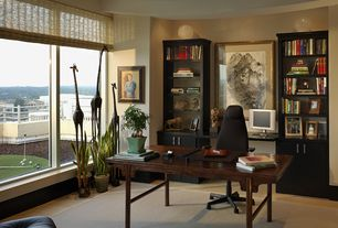 Modern Home Office with Built-in bookshelf, can lights, picture window, Standard height, Laminate floors
