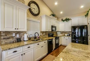 Traditional Kitchen with specialty door, L-shaped, Hardwood floors, Stone Tile, MS International Yellow River Granite, Flush