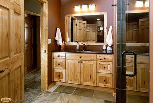 Rustic 3/4 Bathroom with frameless showerdoor, Flat panel cabinets, Undermount sink, Meta marble & granite in absolute black