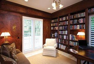 Traditional Home Office with Crown molding, Built-in bookshelf, travertine tile floors, can lights, Chandelier, French doors