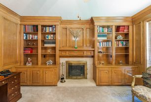 Traditional Home Office with Crown molding, Cement fireplace, Built-in bookshelf, Carpet