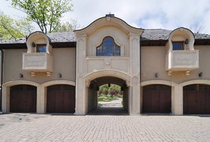 Traditional Garage with High ceiling, Transom window, Brick floors, specialty door, Wall sconce