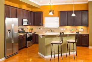 Craftsman Kitchen with Kitchen island, Destiny: breckenridge cabinets, Undermount sink, Pendant light, Breakfast bar