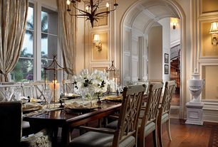 Traditional Dining Room with Casement, Wall sconce, Chandelier, Standard height, Hardwood floors, Wainscotting