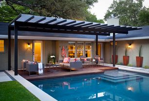 Contemporary Swimming Pool with French doors, Trellis, Pathway, exterior tile floors