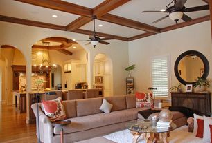 Mediterranean Great Room with Hardwood floors, Built-in bookshelf, Ceiling fan, Box ceiling, Exposed beam, Columns