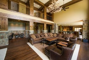 Rustic Great Room with Loft, Macy's langston leather 5 piece power motion sectional sofa, Interior stone wall, Exposed beam
