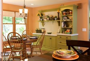 Country Dining Room with Chandelier, can lights, Hardwood floors, Standard height, double-hung window, Built-in bookshelf