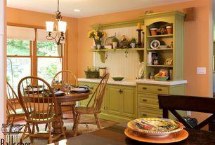 Country Dining Room with Chandelier, Hardwood floors, Built-in bookshelf