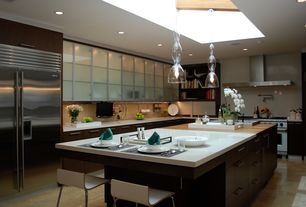 Contemporary Kitchen with Pendant light, L-shaped, Standard height, stone tile floors, Corian counters, Skylight, Wall Hood
