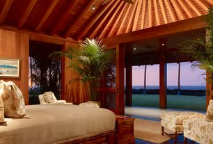 Tropical Guest Bedroom with Columns, Ceiling fan, Mahogany Wood Paneling, Exposed beam, Cathedral ceiling, Pendant light