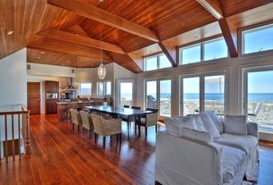 Craftsman Great Room with Laminate floors, specialty door, Pendant light, French doors, Cathedral ceiling, Exposed beam