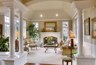 Traditional Living Room with stone fireplace, Box ceiling, Chair rail, Wall frame molding, Carpet, High ceiling, Wainscotting