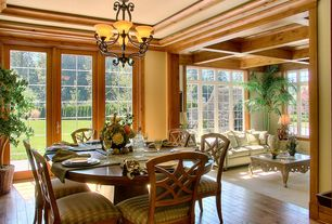 Traditional Dining Room with Chandelier, Crown molding, Hardwood floors, French doors