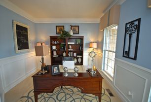Traditional Home Office with Carpet, Built-in bookshelf, double-hung window, Crown molding, Standard height, Wainscotting