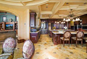 Craftsman Kitchen with travertine tile floors, Built-in bookshelf, Exposed beam, Chandelier