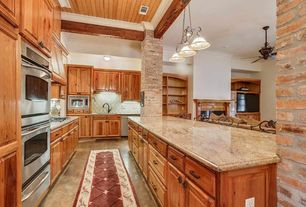 Rustic Kitchen with Custom hood, Kitchen island, Complex granite counters, Undermount sink, Stone Tile, Crown molding