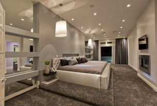 Contemporary Master Bedroom with Shag carpet, Tufted headboard, Cement fireplace, Platform bed, Paint, Carpet, specialty door