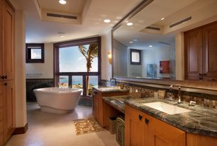 Traditional Master Bathroom with Flat panel cabinets, Flush, Wall sconce, Ceramic Tile, Double sink, Freestanding