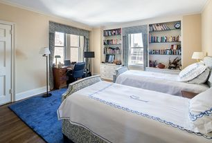 Traditional Guest Bedroom with six panel door, Crown molding, Standard height, Built-in bookshelf, Hardwood floors
