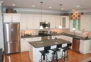 Contemporary Kitchen with dishwasher, Stone Tile, gas range, built-in microwave, full backsplash, Soapstone counters