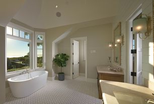 Traditional Master Bathroom with Flat panel cabinets, specialty tile floors, Limestone counters, High ceiling, Transom window