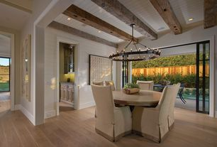 Contemporary Dining Room with Camino Round Chandelier, Exposed beam, Durham Slipcovered Side Chair, Chandelier