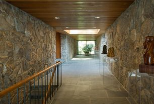 Contemporary Hallway with soapstone tile floors, Skylight