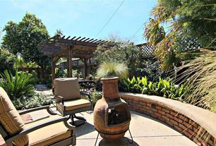 Rustic Patio with Trellis, Raised beds, Pathway, Fence, exterior tile floors, outdoor pizza oven