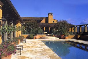 Mediterranean Swimming Pool with exterior tile floors, exterior terracotta tile floors, Raised beds
