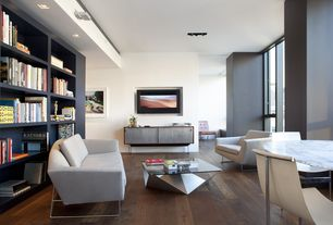 Contemporary Living Room with High Park Arm Chair, Built-in bookshelf, Wall sconce, Cassius Q Deluxe Convertible Sofa