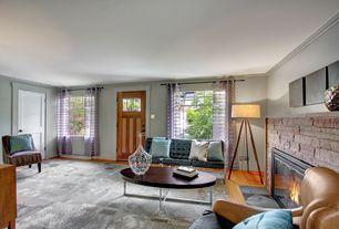 Contemporary Living Room with Hardwood floors, Glass panel door, Crown molding, stone fireplace, specialty door