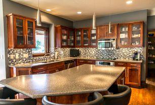 Traditional Kitchen with Kitchen island, Ceramic Tile, Hardwood floors, Flat panel cabinets, Pendant light, Glass panel