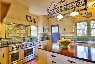 Eclectic Kitchen with Inset cabinets, double oven range, Glass panel door, flush light, Soapstone counters, Casement
