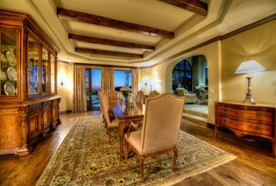 Mediterranean Dining Room with Exposed beam, Crown molding, Wall sconce, French doors, Hardwood floors, High ceiling