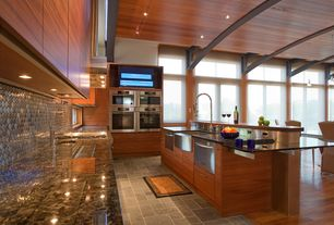 Contemporary Kitchen with Wall Hood, gas range, Pendant light, High ceiling, built-in microwave, Farmhouse sink, Flush