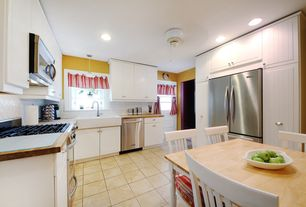 Modern Kitchen with Wood counters, Flush, dishwasher, European Cabinets, full backsplash, Breakfast nook, can lights