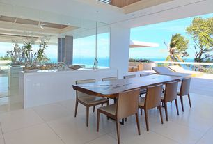 Contemporary Dining Room with Indoor/outdoor living, Glass railing, Built-in bookshelf, Mirror wall, can lights