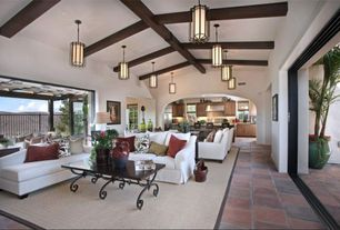 Tropical Great Room with High ceiling, Indoor/outdoor living, Pb comfort roll arm slipcovered sofa, Quentin Pendant
