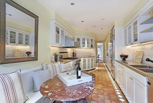 Traditional Kitchen with European Cabinets, Kitchen Craft Coventry Cabinet Door Style, terracotta tile floors, Glass panel