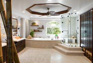 Contemporary Master Bathroom with Vessel sink, Ceiling fan, Handheld showerhead, Flat panel cabinets, Wall sconce, Flush