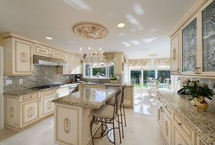 Traditional Kitchen with Complex granite counters, Chandelier, Kitchen island, Complex Granite, two dishwashers, Raised panel