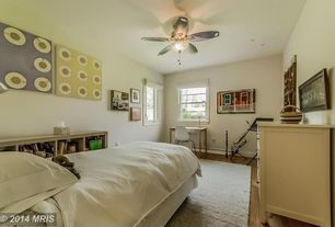Eclectic Guest Bedroom with Ceiling fan, Built-in bookshelf, Hardwood floors