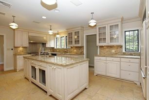 Traditional Kitchen with Ann sacks travertine, dishwasher, Standard height, Casement, Juparana persa granite, Glass panel